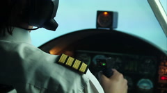 Pilot flying commercial plane, transmitting information by walkie-talkie Stock Footage