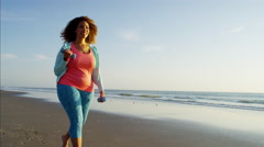 Voluptuous Ethnic African American female walking barefoot along the beach Stock Footage