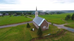 Old catholic church building. Summer nature landscape. Aerial footage. - stock footage