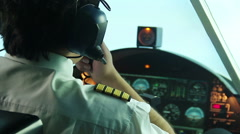 Overworked annoyed pilot operating plane and reporting situation to dispatcher Stock Footage