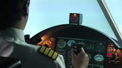 Attentive pilot controlling passenger aircraft, air transportation, travel Stock Footage
