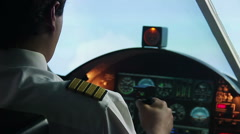 Aviation, pilot operating plane and reporting  situation to dispatcher by radio Stock Footage