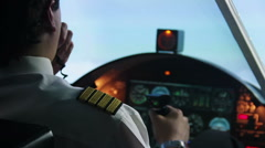 Male pilot flying in autopilot mode, transmitting information by walkie-talkie Stock Footage