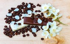 Pieces of white and milk chocolate. jasmine flowers. Black coffee Stock Photos