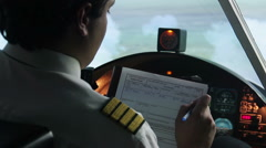 Pilot filling out flight documentation, plane flying in autopilot mode, tourism Stock Footage