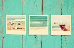 instant polaroid photos album on wooden background - stock photo
