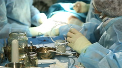 Surgical nurse working with surgical tools in operating room Stock Footage