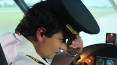 Nervous pilot beginner worried about his first flight, responsibility, airplane Stock Footage