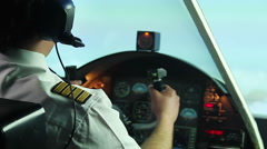 Confident male pilot operating airplane and refusing alcoholic drink in cockpit Stock Footage