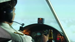 Insane captain of airliner drinking beer with co-pilot in cockpit, danger Stock Footage