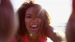 Portrait of afro hair African American female at sunrise at a beach resort  Stock Footage