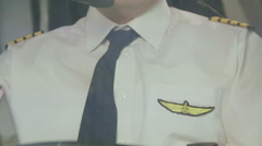 Pilot's insignia on uniform, captain controlling airliner, thinking about home Stock Footage