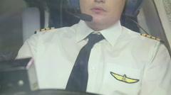 Airline captain flying plane, transmitting information over radio to dispatcher Stock Footage