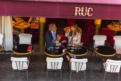 Parisian enjoy food and drinks in cafe sidewalk in Paris - stock photo