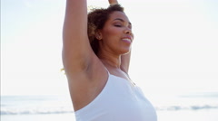 Portrait of sultry plus size African American female in sun flare on the beach Stock Footage