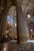 Sunbeams in Catedral de Sevilla, Spain - stock photo