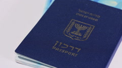 Rotating israeli money bills of 200 shekel and israeli passport Stock Footage