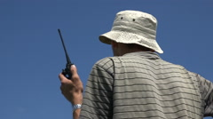 Man With Hand Radio Station Manages Flights of Paragliders.summer Sunny Day Stock Footage