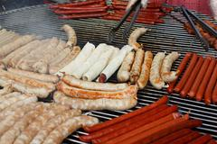 Street fast food, grilled sausages at bbq Stock Photos