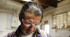 A carpenter taking off his safety googles Stock Footage