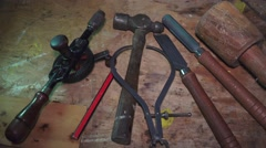 Craftsman's  Vintage hand tools on bench - stock footage
