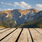 mountain landscape and empty wooden deck table. Ready for product montage dis - stock photo