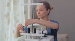 woman refills threads in overlock - stock footage