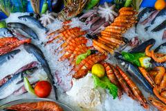 Fresh seafood in the fridge of the seafood restaurant in Crete, Greece Stock Photos