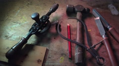 Workman tools, Vintage hand tools on bench - stock footage