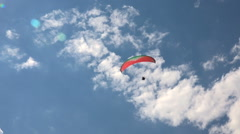 Flying Paraglider on a Background of the Sun and Beautiful Clouds Stock Footage