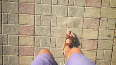 The man in flip flops walking along a track (slow motion) Stock Footage