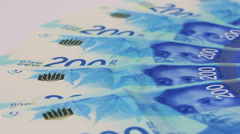 Rotating israeli money bills of 200 shekel Stock Footage