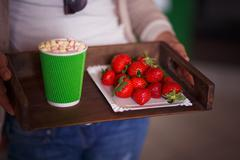 Tray with coffe and strawberries Stock Photos