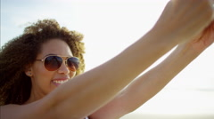 A beautiful young African American female taking selfies Stock Footage