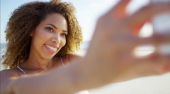 Afro hair African American female at sunset with a smart phone taking selfies Stock Footage
