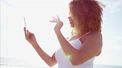 Smiling plus size Ethnic African American female at sunset messaging  Stock Footage