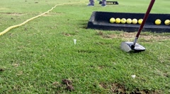 Golf Player Puts Golf Ball On Dispenser And Aims HD Driving Range Stock Footage