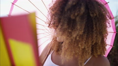 Afro hair Ethnic African American female enjoying summer freedom reading a book Stock Footage