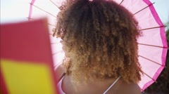Beautiful afro hair African American female reading a book  Stock Footage