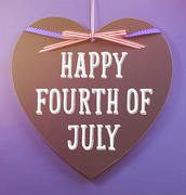 Fourth of July greeting on heart shape blackboard - stock photo