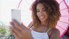 Voluptuous African American female relaxed and listening to music with a phone Stock Footage