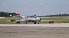 Mig 17 taxi to full stop - stock footage