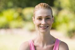 Close-up of beautiful woman with a zoom in park Stock Photos