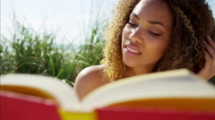 Portrait of plus size African American female reading a book   Stock Footage