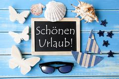 Blackboard With Maritime Decoration, Schoenen Urlaub Means Happy Holidays Stock Photos
