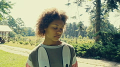 Offended and sad beautiful curly little african girl outdoor portrait. Upset Stock Footage