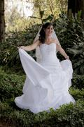 Beautiful sexy bride exploring the wonders of a forest. Stock Photos