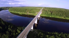 A car quickly goes over the bridge - aerial view Stock Footage