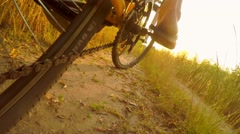 Slow motion man rides a bike on a country road near Stock Footage