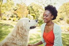 Woman posing with her dog at park Stock Photos